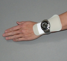 SureWrist under a wrist watch